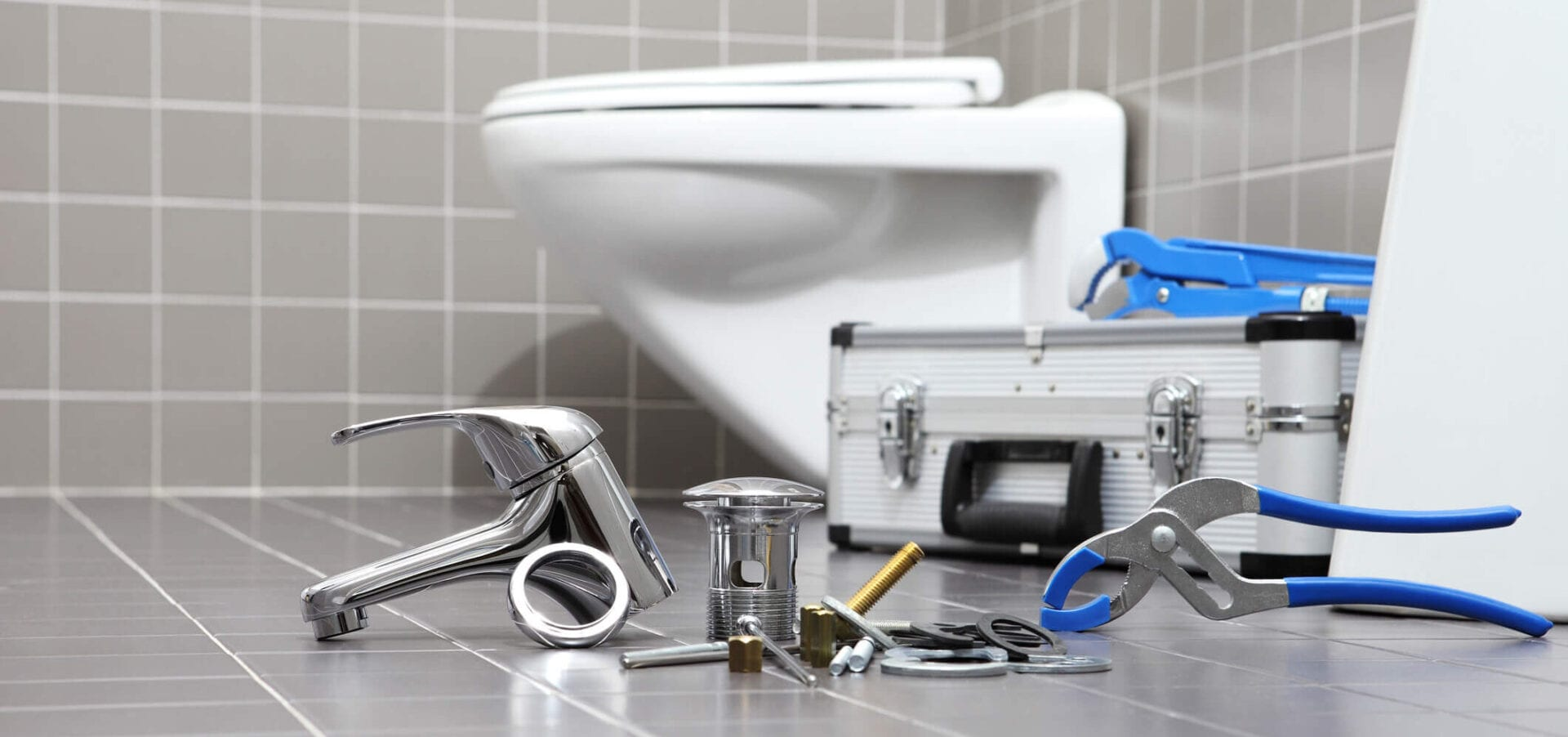 plumber tools and equipment in a bathroom, plumbing repair service, assemble and install concept.